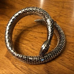 Silver tone snake wrap bracelet.